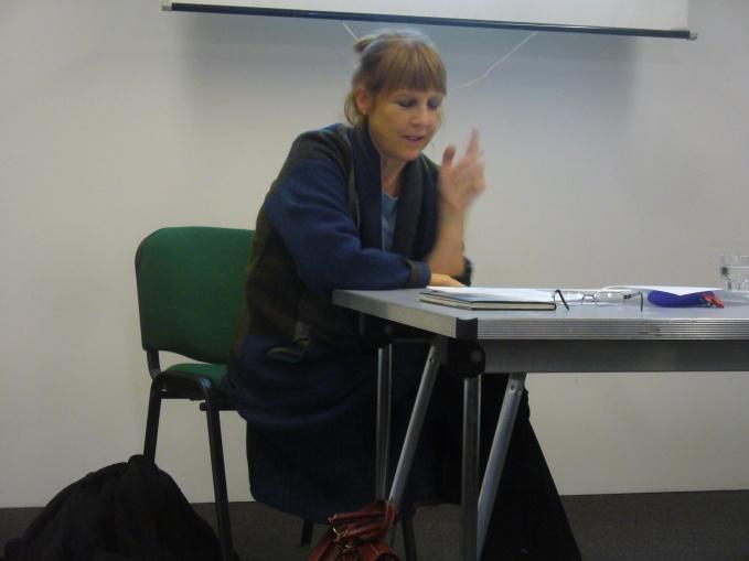 Dr. Lisa Dart reading, thinking, performing